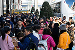 Foreign visitors line up to enter board their tour bus with their shopping in the Ginza district on January 20, 2016, Tokyo, Japan. The Japan National Tourism Organization reported on Tuesday 19th a record increase in foreign visitors in 2015. Approximately 19.73 million people visited Japan from abroad, up 47.3 percent. According to the report there were more Chinese visitors than from any other nation with 4.99 million coming in 2015. South Korea (4 million) and Taiwan (3.67 million) were next on the list, and over 1 million Americans also visited Japan in 2015. The number of visitors is the highest in 45 years and already close to Japan's goal of attracting 20 million foreign visitors in a year by 2020. (Photo by Rodrigo Reyes Marin/AFLO)