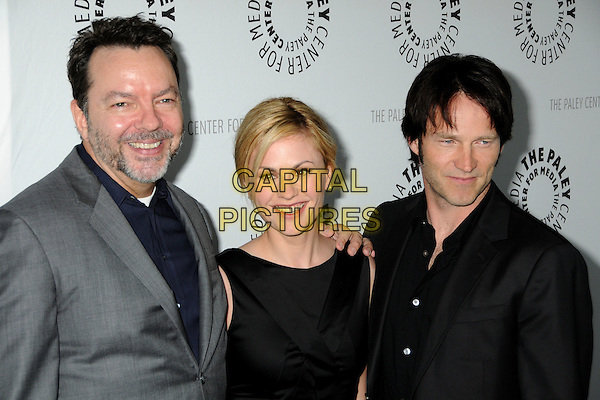 "ALAN BALL, ANNA PAQUIN & STEPHEN MOYER.The 26th Annual William S. Paley Television Festival presents ""True Blood"" held at Arclight Cinemas, Hollywood, California, USA..April 13th, 2009.half length black dress sleeveless shirt suit jacket couple grey gray stubble beard facial hair .CAP/ADM/BP.©Byron Purvis/AdMedia/Capital Pictures."