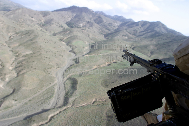 Chinook flies over Afghistan - picture from rear of chinook..PICTURE: HELEN ATKINSON..REPORTER: WAYNE FRANCIS