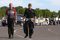 May 31, 2013; Englishtown, NJ, USA: NHRA top fuel dragster driver Shawn Langdon (right) walks with a crew member during qualifying for the Summer Nationals at Raceway Park. Mandatory Credit: Mark J. Rebilas-
