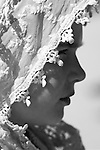 Young girl wearing a lace <br /> shaul over head
