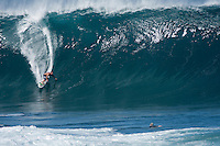 Pro Surfer Kalani Chapman getting barreled on a big wave at Pipeline, North Shore, Oahu