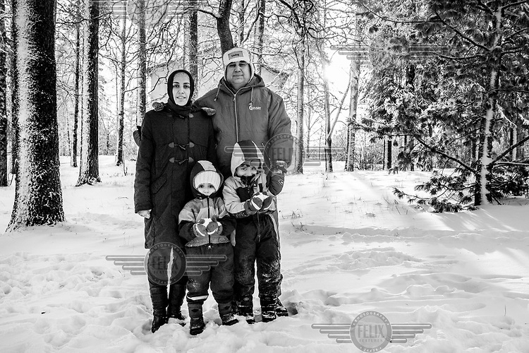 The Tameh family, Syrian refugees, in the grounds of the Tarina refugee shelter.
