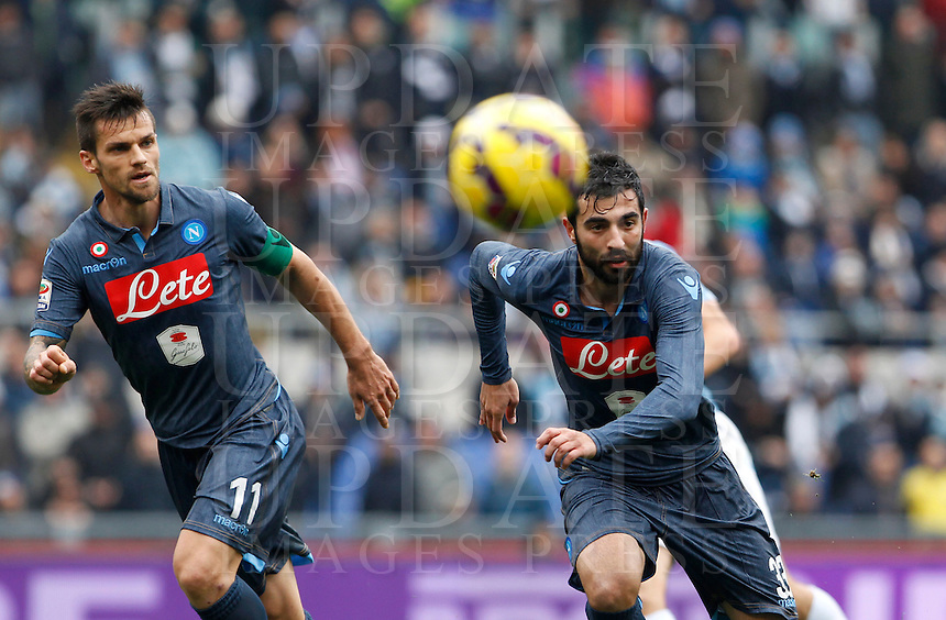 Calcio, Serie A: Lazio vs Napoli. Roma, stadio Olimpico, 18 gennaio 2015.<br /> Napoli&rsquo;s Christian Maggio, left, and Raul Albiol in action during the Italian Serie A football match between Lazio and Napoli at Rome's Olympic stadium, 18 January 2015.<br /> UPDATE IMAGES PRESS/Isabella Bonotto