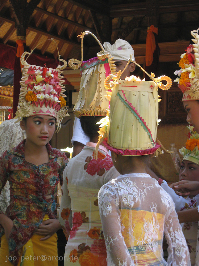 young balinese dancers preparing for  sacred dance pendet and blessing ritual for purifying family house compound in larger, day-long ceremonies, North of Ubud,   Bali, archipelago Indonesia, 2010
