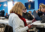NAUGATUCK, CT. 08 December 2018-120818 - Lynn Allen whose husband Raymond was a Vietnam Veteran looks at her certificate she was given during the honoring of Vietnam Veterans Spouses, part of the the Certificate of Honor Program at the American Legion Post 17 in Naugatuck on Saturday. This is the first time in Connecticut that any type of honor has been given to the spouses. Bill Shettle Republican-American