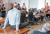 President Jonathan Veitch talks to students in the Cushman Board room of the AGC, where a lunch was already happening. Occidental College students march in a rally organized by Fossil Free Occidental on Nov. 14, 2014. The group hopes to end Oxy's reliance on fossil fuels by freezing all investments in the 200 largest fossil-fuel companies (measured by their proven carbon reserves in oil, gas or coal) and over the next five to ten years sell the stock in these same companies, and then reinvest 5%, at minimum, of the divested portfolio in socially responsible investments. (Photo by Marc Campos, Occidental College Photographer)