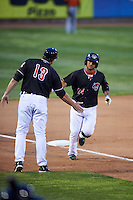 Erie SeaWolves second baseman Alberto Gonzalez (24) congratulated by manager Lance Parrish (13) after hitting a home run during a game against the Bowie Baysox on May 12, 2016 at Jerry Uht Park in Erie, Pennsylvania.  Bowie defeated Erie 6-5.  (Mike Janes/Four Seam Images)