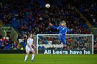 Wednesday 05 March 2014<br /> Pictured: Birkir Bjarnason of Iceland jumps high for the ball as Joe Allen of Wales looks on <br /> Re: International friendly Wales v Iceland at the Cardiff City Stadium, Cardiff,Wales UK