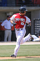 Yonder Alonzo #19 of the Carolina Mudcats running home to score during a game against the Chattanooga Lookouts on on May 9, 2010 in Zebulon, NC.