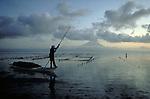 Seaweed harvester at dawn on the island of Nusa Lembogan near Bali, Indonesia.  CD scan from 35mm film.. © John Birchard