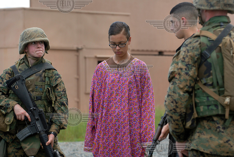 Marine officers role-playing the arrest of insurgents. The Basic School at Camp Barrett, Quantico, Virginia is where all incoming Marine officers are trained. Seven companies of about 300 officers come through every year..