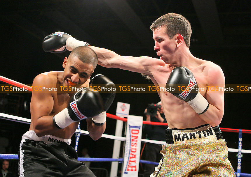 Martin Ward (gold shorts) defeats Mo Khaled in a Featherweight Boxing contest at the Kingsway Leisure Centre, Widnes, promoted by Matchroom Sports - 07/05/10 - MANDATORY CREDIT: Chris Royle/TGSPHOTO - Self billing applies where appropriate - Tel: 0845 094 6026.