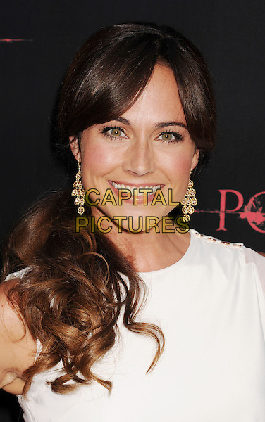 "Nikki DeLoach.""The Possession"" Los Angeles Premiere held at Arclight Cinemas, Hollywood, California, USA..August 28th, 2012.headshot portrait dangling earrings gold white smiling m .CAP/ROT/TM.©Tony Michaels/Roth Stock/Capital Pictures"