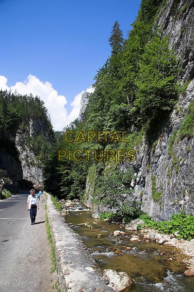 Tourist walking in Bicaz Gorge, Cheile Bicazului Hasmas, Southern Moldavia, Romania