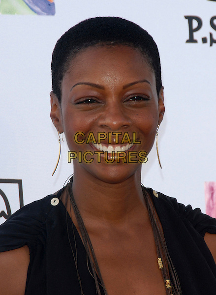 JENISA MARIE WASHINGTON .Attends Los Angeles Antiques Show Preview Party held at Barker Hangar in Santa Monica, California, USA..April 25th, 2007.headshot portrait gold earrings  .CAP/DVS.©Debbie VanStory/Capital Pictures