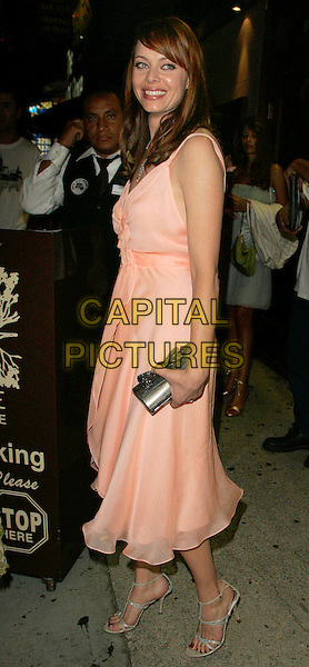 MELINDA CLARKE.Spotted at Hyde Lounge located on Sunset Boulevard,.West Hollywood, California, Los Angeles, USA, .26 August 2006..full length peach coral dress clutch bag.Ref: ADM/JL.www.capitalpictures.com.sales@capitalpictures.com.©Jackson Lee/AdMedia/Capital Pictures.