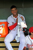 Second baseman Yoan Moncada of the Greenville Drive, top, sits in the dugout before a game against the Lexington Legends on Tuesday, May 19, 2015, at Fluor Field at the West End in Greenville, South Carolina. The Cuban-born 19-year-old Red Sox signee has been ranked the No. 1 international prospect in baseball by Baseball America. (Tom Priddy/Four Seam Images)