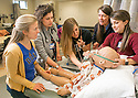 Associate Professor Anne Derouin, DNP, RN, CPNP, FAANP, teaches Master of Science in Nursing (MSN) students about treating asthma during a pediatric clinic program at the Duke University School of Nursing.