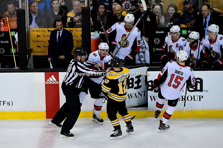 April 7, 2018: Linesman Scott Driscoll (68) separates /Ottawa Senators right wing Alexandre Burrows (14) and Boston Bruins right wing Brian Gionta (12) during the NHL game between the Ottawa Senators  and the Boston Bruins held at TD Garden, in Boston, Mass. Boston defeats Ottawa 5-2 Eric Canha/CSM
