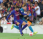 Bale and Gerard Pique in action during Supercopa de España game 1 between FC Barcelona against Real Madrid at Camp Nou