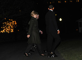 Washington, DC - December 1, 2009 -- United States President Barack Obama (R), Secretary of State Hillary Rodham Clinton (L) and Defense Secretary Robert Gates walk across the South Lawn of the White House to board Marine One in Washington on Tuesday, December 1, 2009. President Obama is traveling to West Point Military Academy in New York to speak on a planned increase of troops and exit strategy for the war in Afghanistan. Chairman of the Joint Chiefs of Staff Admiral Michael Mullen (not pictured) also traveled with President Obama. .Credit: Alexis C. Glenn / Pool via CNP