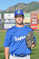 Ryan Taylor (15) of the Ogden Raptors poses for a photo during media day on June 14, 2014 at Lindquist Field in Ogden, Utah. (Stephen Smith/Four Seam Images)