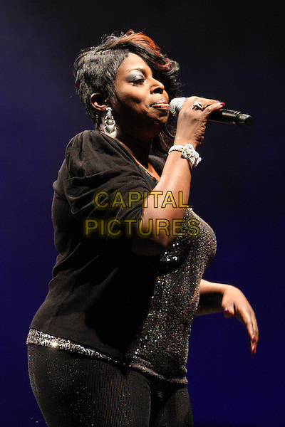 ANGIE STONE.Performing live at the Hammersmith Apollo, London, England..March 5th, 2010.stage concert gig performance music half length black jacket top singing profile .CAP/MAR.© Martin Harris/Capital Pictures.