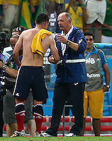 Brazil head coach Luiz Felipe Scolari consoles an emotional James Rodriguez of Colombia as he leaves the field at full time