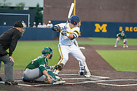 Michigan Wolverines catcher Harrison Wenson (7) at bat against the Eastern Michigan Hurons on May 3, 2016 at Ray Fisher Stadium in Ann Arbor, Michigan. Michigan defeated Eastern Michigan 12-4. (Andrew Woolley/Four Seam Images)