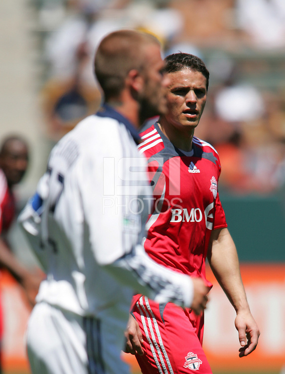 Toronto FC midfielder (32) Laurent Robert  and LA Galaxy midfielder (23) David Beckham during a MLS match. Toronto defeated the LA Galaxy 3-2 at the Home Depot Center Carson, California, Sunday April 13, 2008.