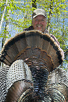 Happy hunter with wild turkey