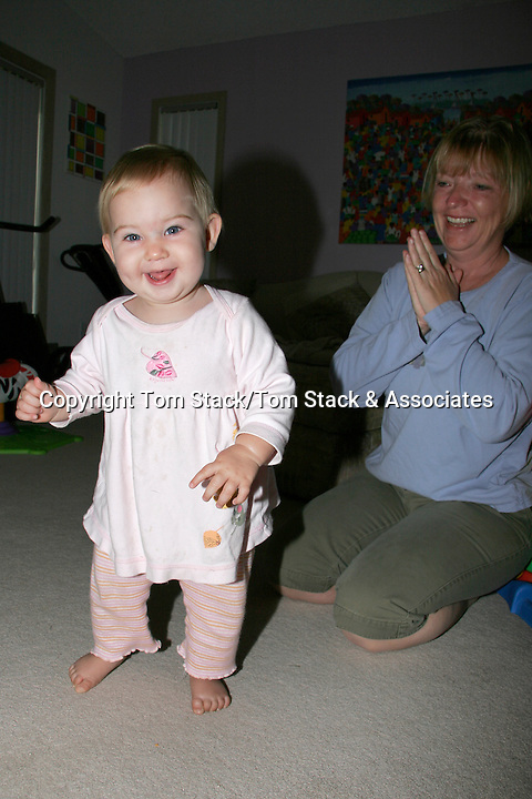 Granddaughters first steps with grandmother