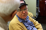 Jim has a conversation with Walden, an 84-year-old veteran who has been coming to shop for years. Walden and Jim spent about 30 minutes discussing the Bible and God. Photo taken at Jim Cloud Barbershop in London, Ky. on October 26, 2012. Photo by Quianna Lige