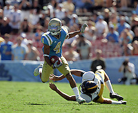 LOS ANGELES,CA - OCTOBER 9,2009: UCLA's Terrence Austin gets past Cal's Vince D'Amato during 1st quarter action. UCLA Bruins vs. California Golden Bears, in an NCAA Pac 10 football game at the Rose Bowl, Sat. Oct 17, 2009..(Photo: Spencer Weiner/Los Angeles Times)