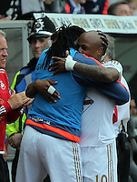 Andre Ayew of Swansea City celebrates his equaliser with team mate Bafetibi Gomis during the Swansea City FC v Manchester City Premier League game at the Liberty Stadium, Swansea, Wales, UK, Sunday 15 May 2016