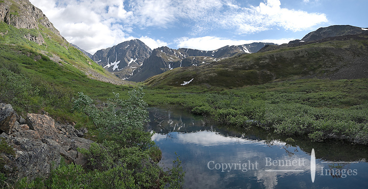 The Chugach Mountains rise up from the north end of Symphony Lake, near Anchorage, Alaska.