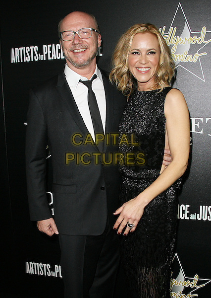 27 February 2014 - West Hollywood, California - Paul Haggis, Maria Bello. Hollywood Domino&rsquo;s 7th Annual Pre-Oscar Charity Gala held at Sunset Tower Hotel. <br /> CAP/ADM/<br /> &copy;AdMedia/Capital Pictures
