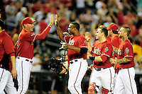 Jun. 1, 2011; Phoenix, AZ, USA; Arizona Diamondbacks outfielder Justin Upton (right) is congratulated by manager Kirk Gibson after hitting a walk off single against the Florida Marlins at Chase Field. The Diamondbacks defeated the Marlins 6-5. Mandatory Credit: Mark J. Rebilas-