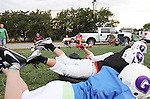 CHAD PILSTER &bull;&nbsp;Hays Daily News<br /> <br /> Parents watch as their kids do a drill that involves diving on a pad on Tuesday, September 10, 2013, during practice of the third grade Gamblers of the Hays Football Association  at Aubel-Bickle Park in Hays, Kansas.