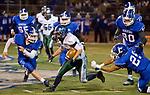 Damonte Ranch Mustangs Samuel Banghart runs through the Carson Senators defense during their football game played on Friday night, October 4, 2013 at Carson High School.