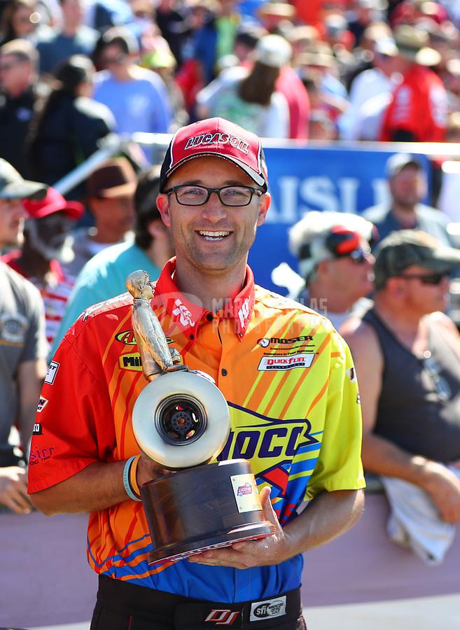 Mar 19, 2017; Gainesville , FL, USA; NHRA super comp driver Jacob Elrod celebrates after winning the Gatornationals at Gainesville Raceway. Mandatory Credit: Mark J. Rebilas-USA TODAY Sports