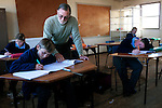 KLEINFONTEIN, SOUTH AFRICA - JULY 15: A teacher helps students during a geography class in the CVO school on July 15, 2013 in Kleinfontein outside Pretoria, South Africa. The all white town with about one thousand residents are all Afrikaners with a Vortrekker heritage. Only white Afrikaners who share Afrikaner culture, language and religion are allowed to settle in the town. (Photo by: Per-Anders Pettersson)