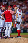 6 October 2017: Washington Nationals starting pitcher Stephen Strasburg listens to words from pitching coach Mike Maddux during the first game of the NLDS against the Chicago Cubs at Nationals Park in Washington, DC. The Cubs shut out the Nationals 3-0 to take a 1-0 lead in their best of five Postseason series. Mandatory Credit: Ed Wolfstein Photo *** RAW (NEF) Image File Available ***