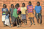 Children in Kaluhoro, Malawi. With support from the Ekwendeni Hospital AIDS Program, villagers here participate in a Building Sustainable Livelihoods program, working together to earn and save money, raise more nutritious food, and receive vocational training.