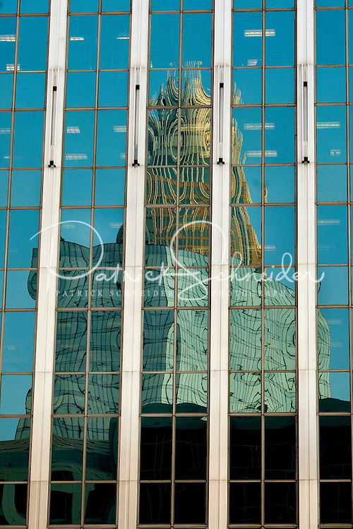 The Bank of America tower reflects in the windows of a neighboring highrise in downtown Charlotte, NC