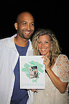 "General Hospital Laura Wright ""Carly"" poses with Tyrone who went to the same high school, Surrattsville in Maryland at a Wine Tasting for Standing Sun Wines on August 11, 2012 at MaGooby's Joke House in Timonium, Maryland. The fans got a chance to takes all the various wines, a Q&A, photos, autographs. L(Photo by Sue Coflin/Max Photos)"