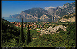 Italy, Dolomites.  Edit to Learn.<br /> Editing your photos makes you a better photographer. Upon closer scrutiny, maybe I should have moved to the right. This would have positioned the two trees on the left, even further to the left and made a better frame. C'est la vie.<br /> Riva del Garda, along Lake Garda, Dolomites, northeast Italy.