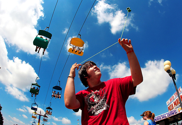 Quinton Haley of Exira performs some impromptu yo-yo tricks along the Grand Concourse at the Iowa State Fair Saturday, August 21, 2010.