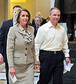 United States House Speaker Nancy Pelosi (Democrat of California), left, walks with Dr. Ed Morris, right, of Franklin, North Carolina through Statuary Hall in the U.S. Capitol as she and other Democratic Leaders meet reporters to announce the savings to the federal budget by their health care reform effort in the U.S. Capitol in Washington, D.C. on Thursday, March 18, 2010..Credit: Ron Sachs / CNP